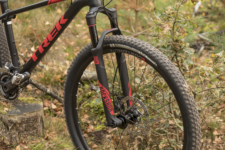 The tensile ProCaliber 8 has a RockShox Reba RL fork with 100 mm of travel and a lockout.