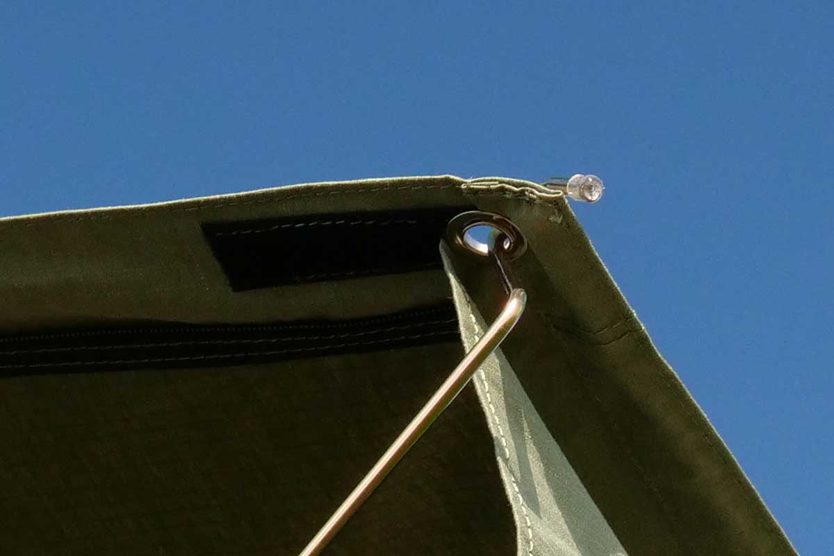 The awnings are connected with a hook and a ring on one end.