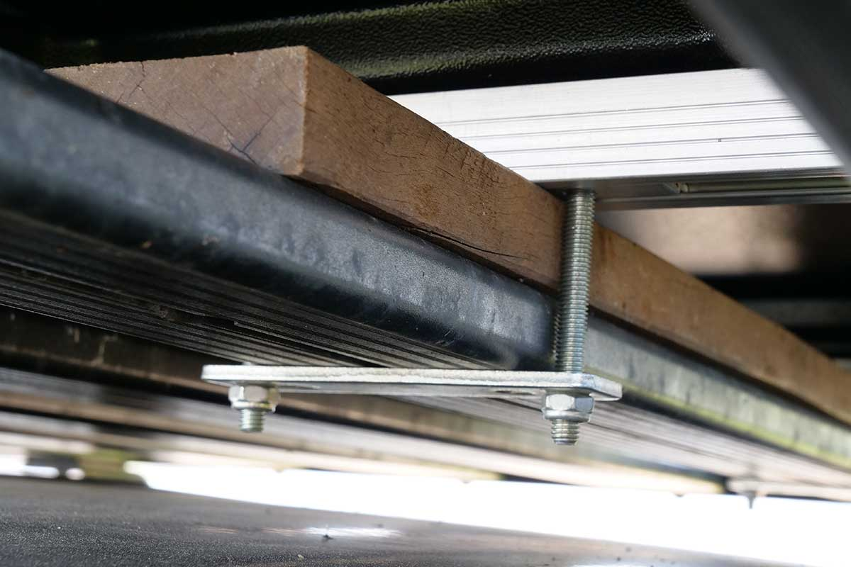 A bracket connects the Hopper to a load-bar or roof rack.
