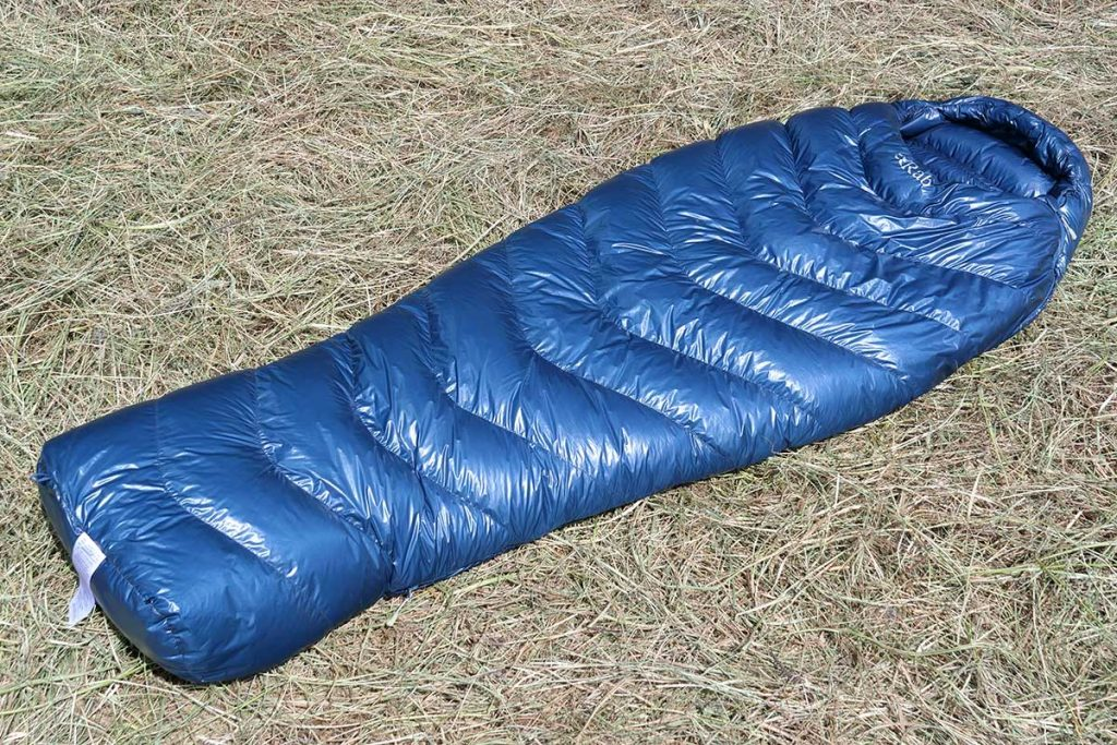 The Rab Mythic 600 is a mummy sleeping bag filled with down and suitable for 4-season camping.