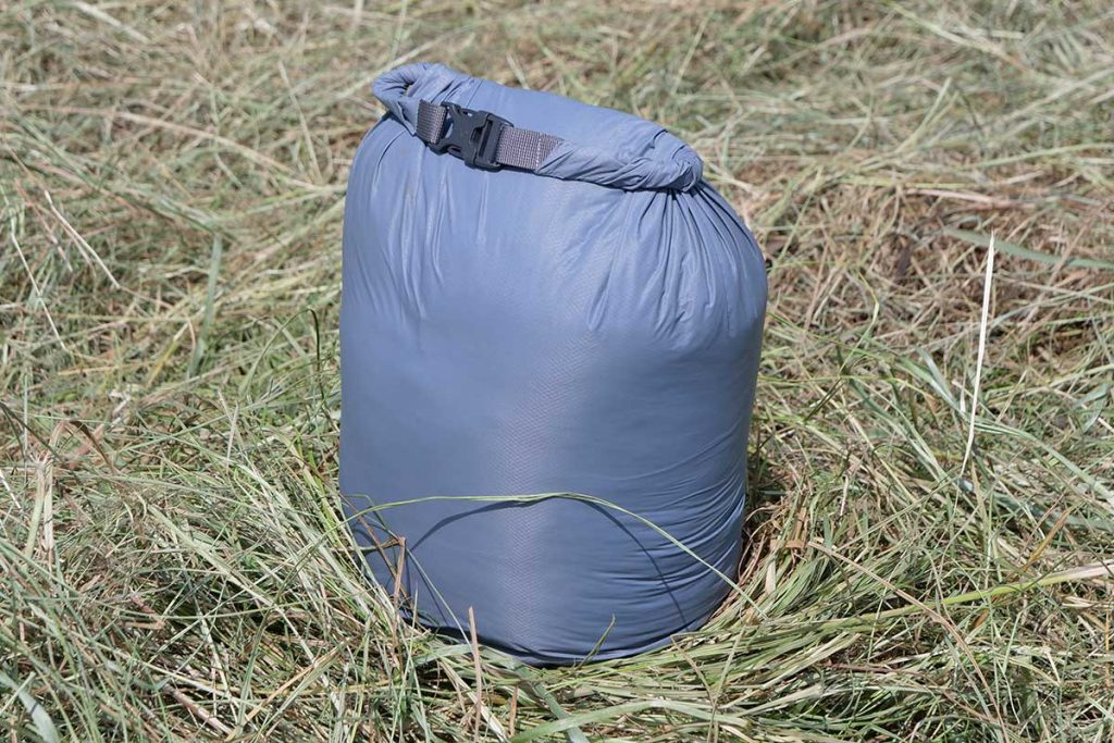 The stuff bag has a roll top.