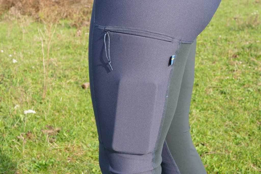 On the left the Fjällräven Abisko Trekking Tights has a zipped pocket.