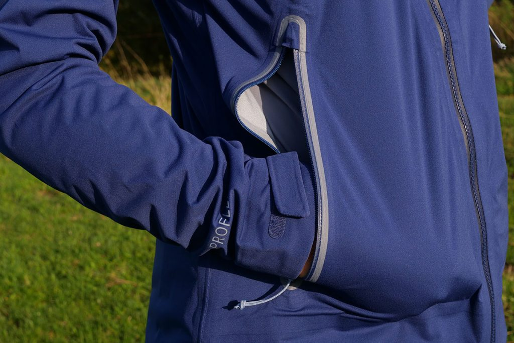 The two pockets of the Rab Kinetic Plus Jacket are closed with a waterproof zipper.