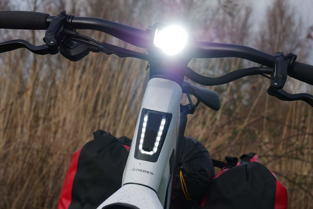 The light in the front: the running light for being seen, the head light for seeing in the dark.