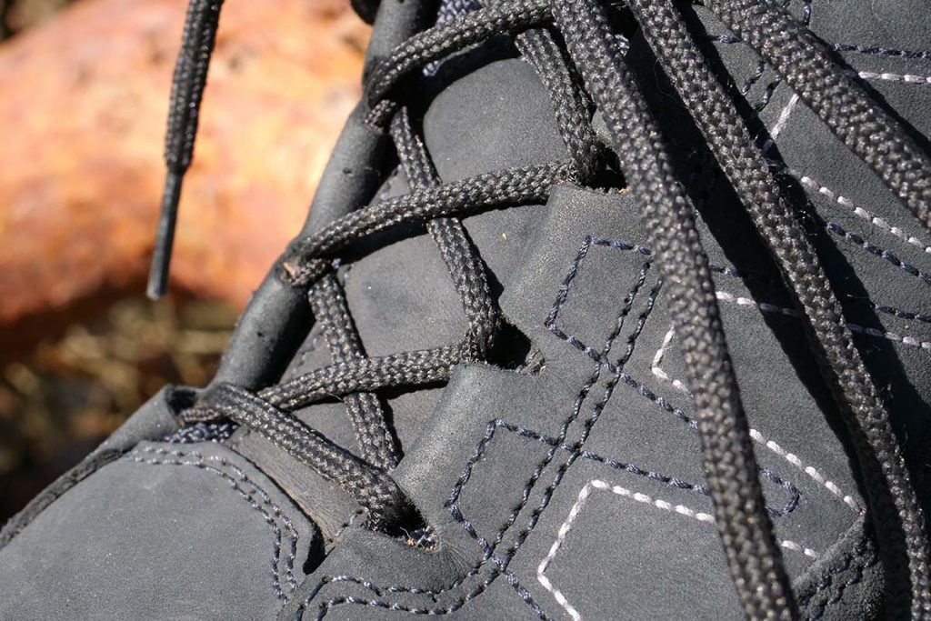 The laces slide easily through the nylon eyelets that is in fact a wire through the leather 'eyelets'.