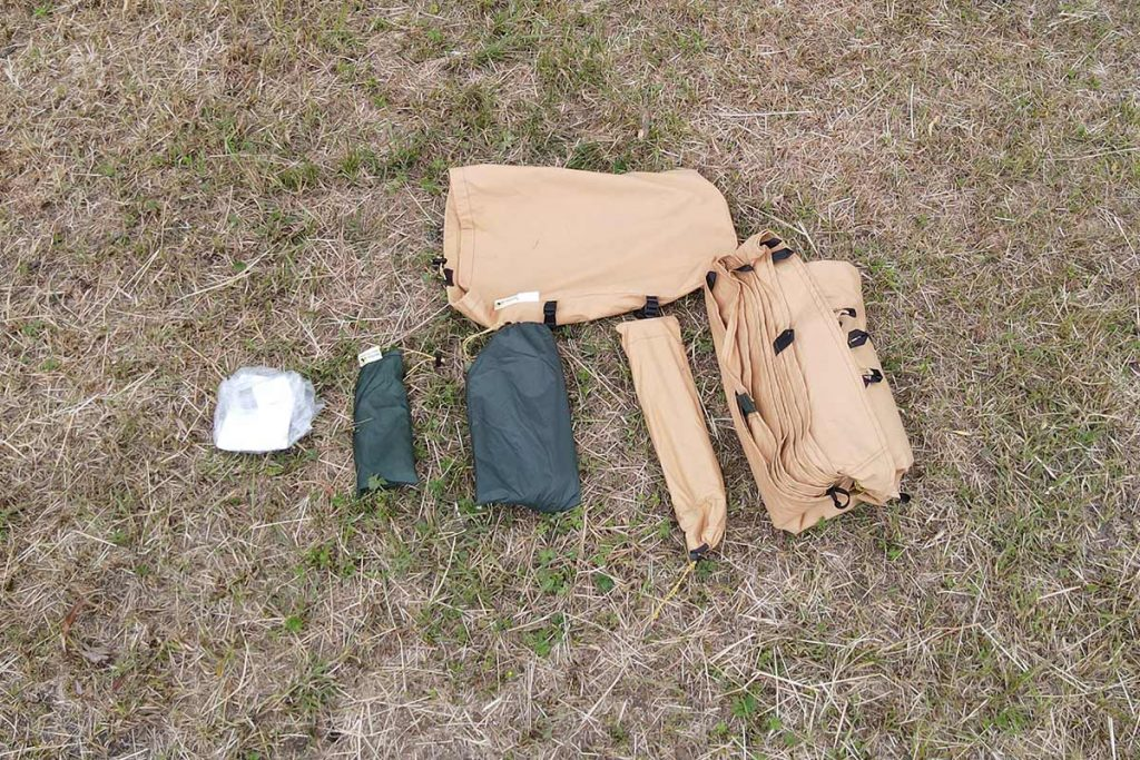 Stuff-bag, instructions, pole, pegs, repair kit, floor and tent.