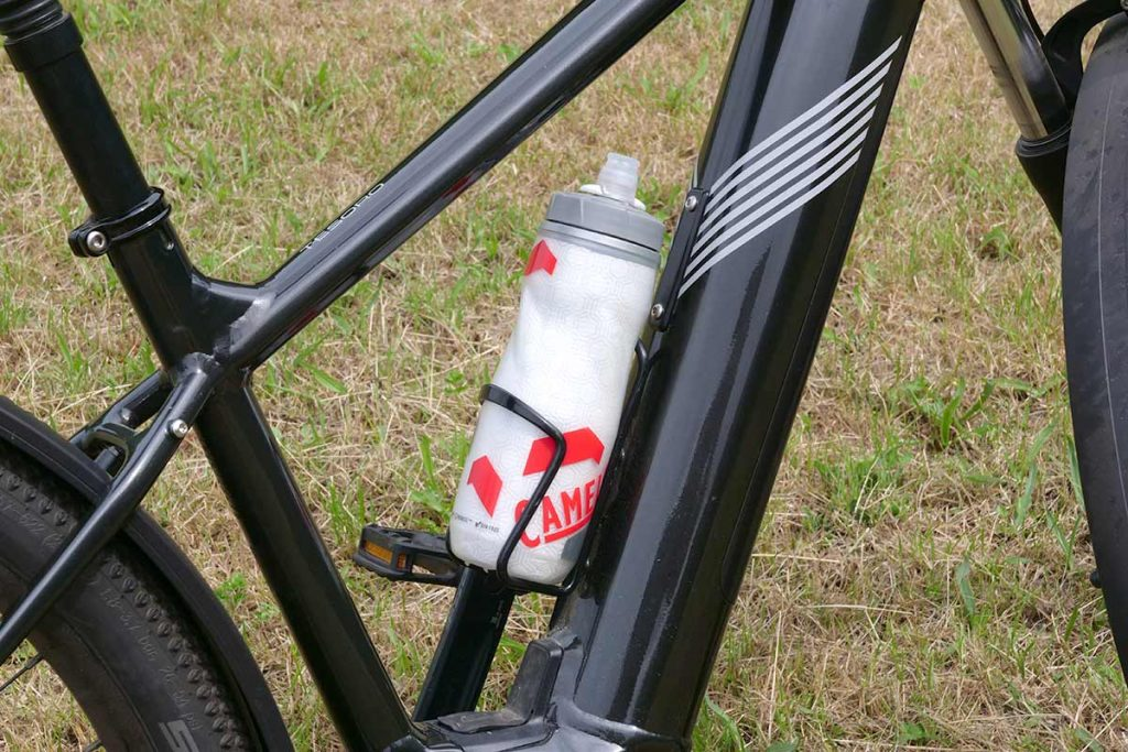 The frame has a place for a bottle cage... if you don't need the second the battery.
