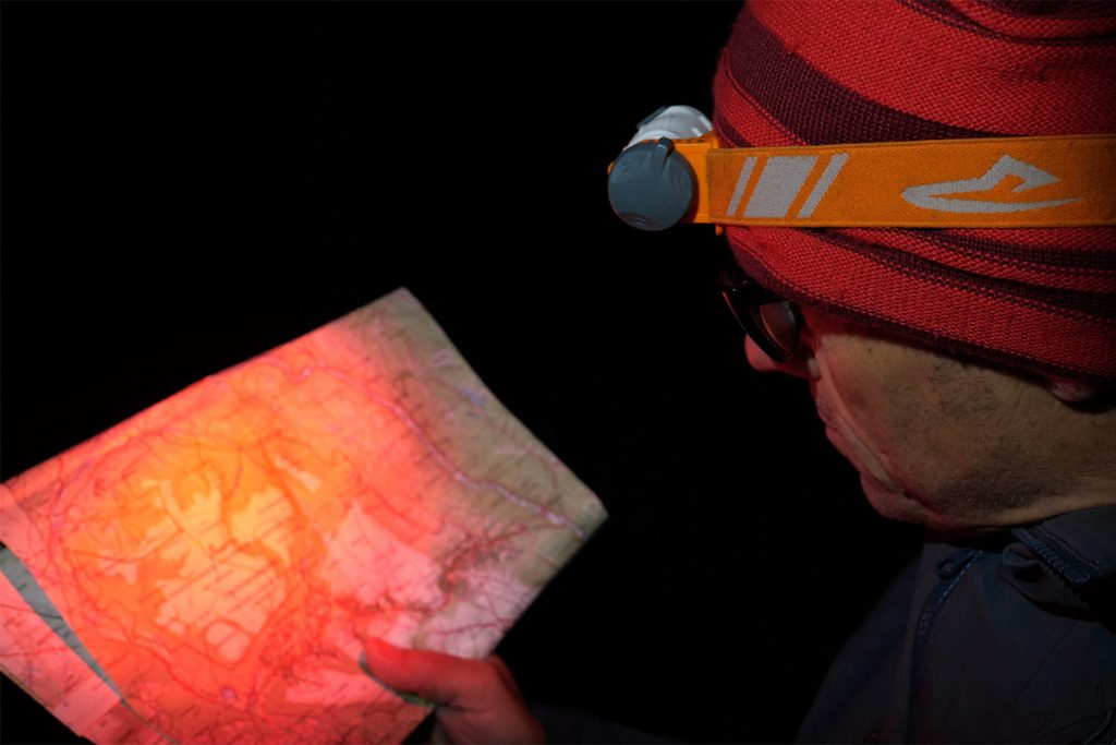 The Petzl Iko Core should have a red LED for reading!