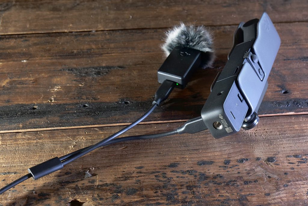 I can charge the microphone and the DJI Pocket 2 simultaneously with the split cable