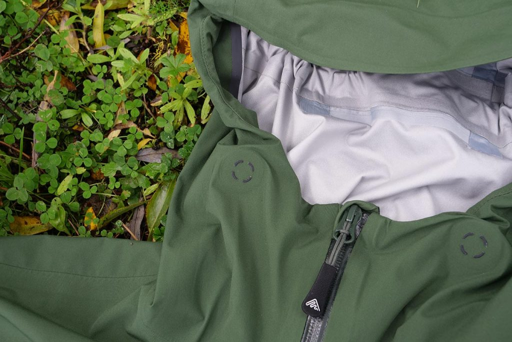 Two buttons on teh Cortazu Hard Shell All Season Jacket operate the hood/collar adjustment.