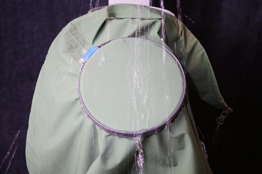 The Cortazu Hard Shell All Season Jacket in the spray test setup to test the DWR-coating.