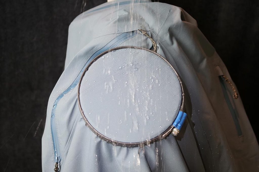 The Fjällräven Keb Eco-Shell Jacket undergoing the spray test to test the DWR-coating.